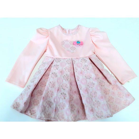 Rózsaszín mintás alkalmi ruha,elején bagollyal